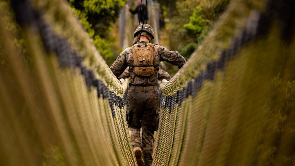 U.S. Marines with 2nd Battalion, 3rd Marine Regiment, conduct an endurance course