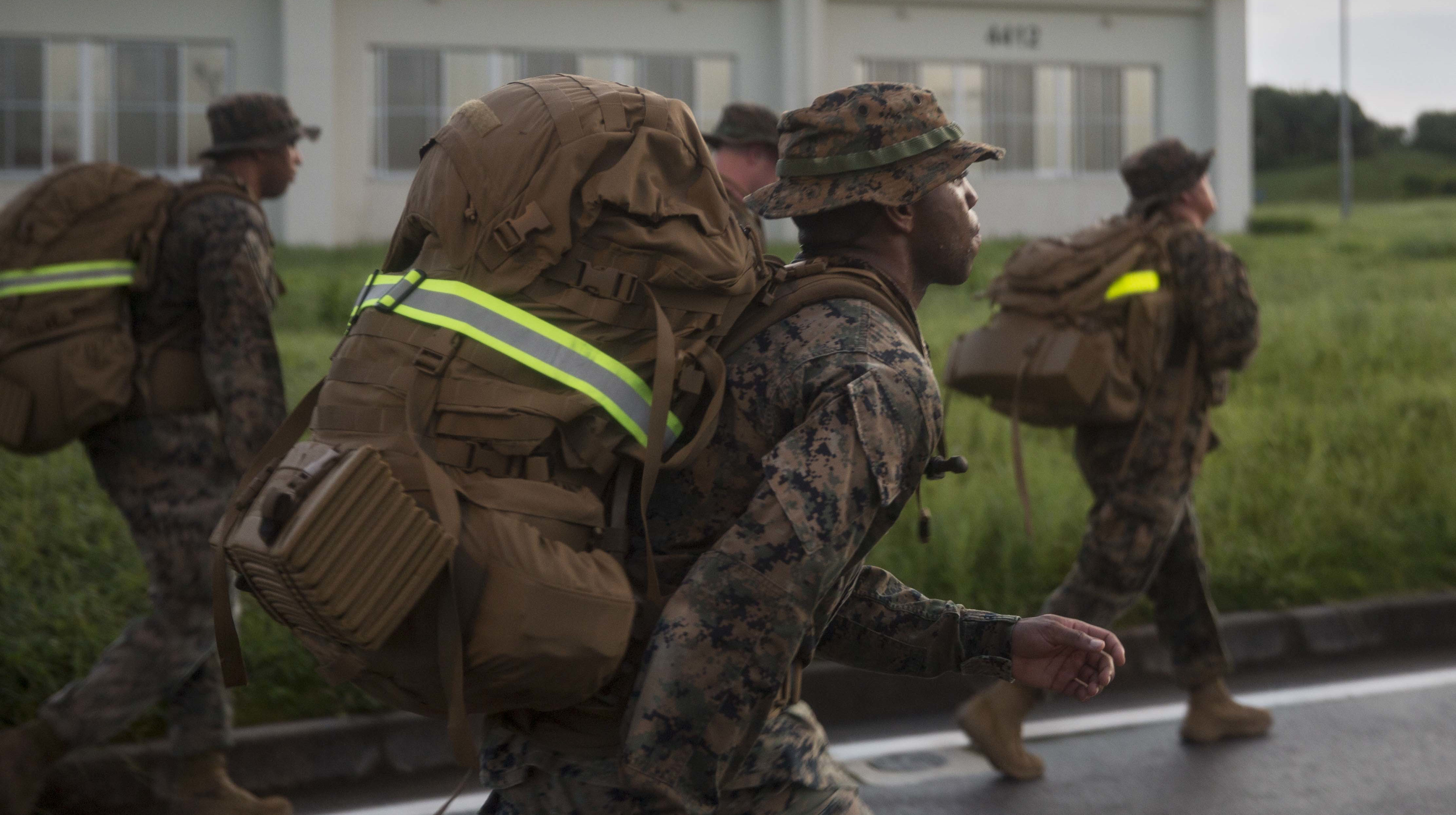 Headquarters Battalion, 3rd Marine Division conduct 6 mile hike